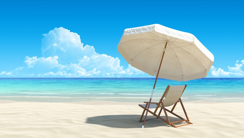 A tropical beach with a chair and umbrella.