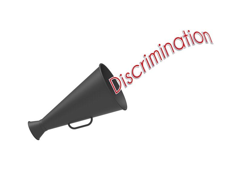"A megaphone with the caption, ""discrimination."""