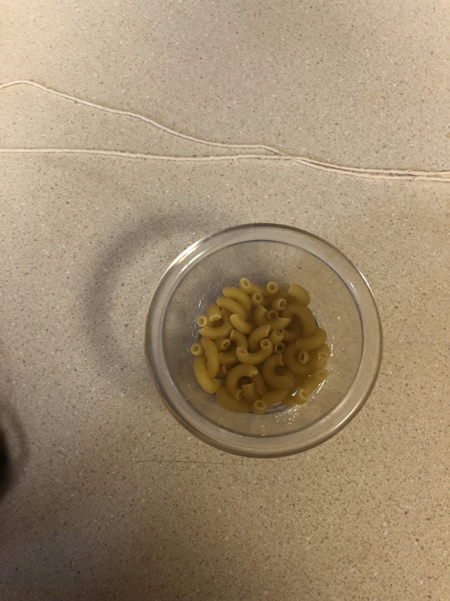 Small cup of macaroni with the string above it.