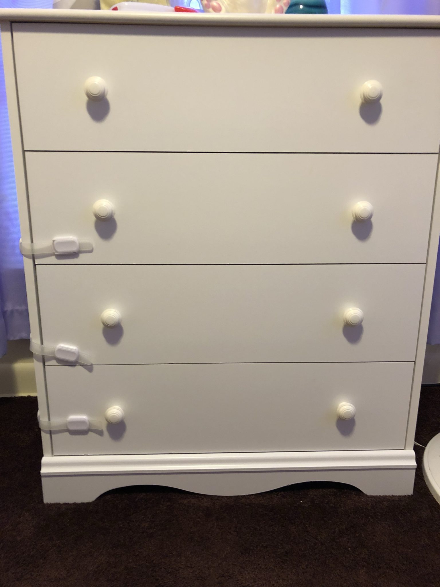 A dresser with locks on the drawers.
