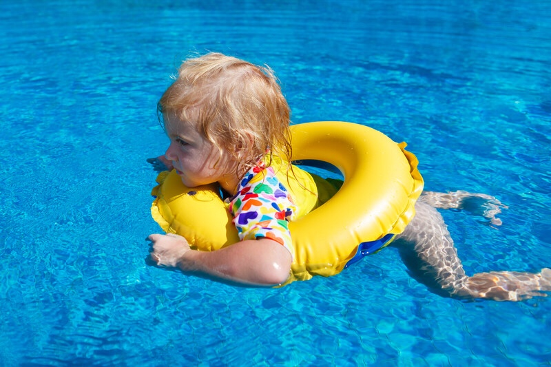 Baby in a pool on a float.