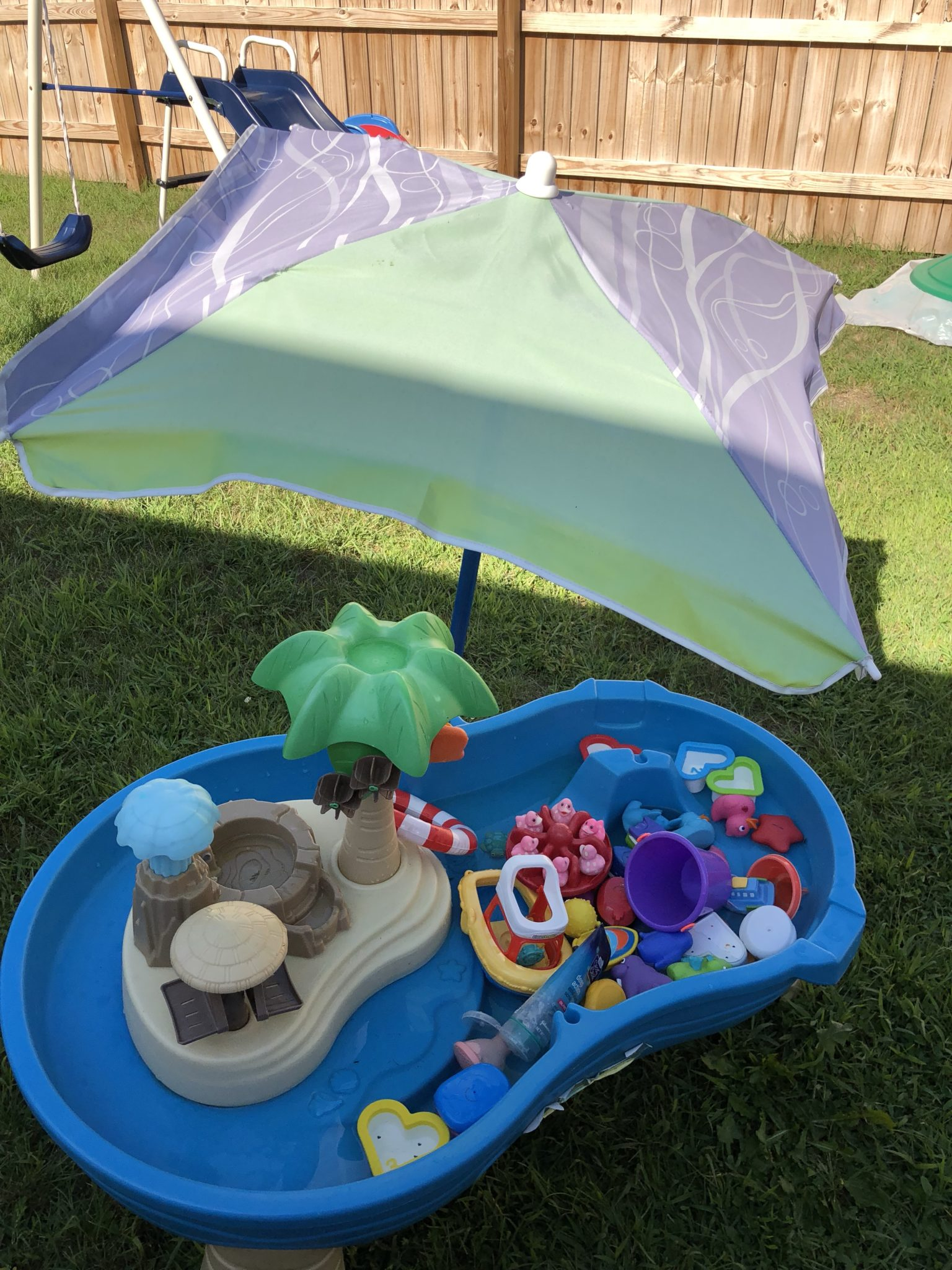 Umbrella over water table.