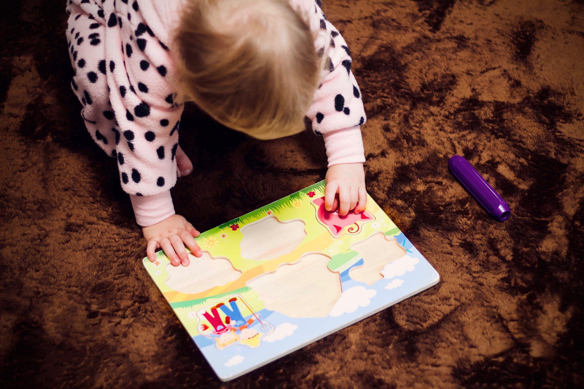 Child solving a puzzle.