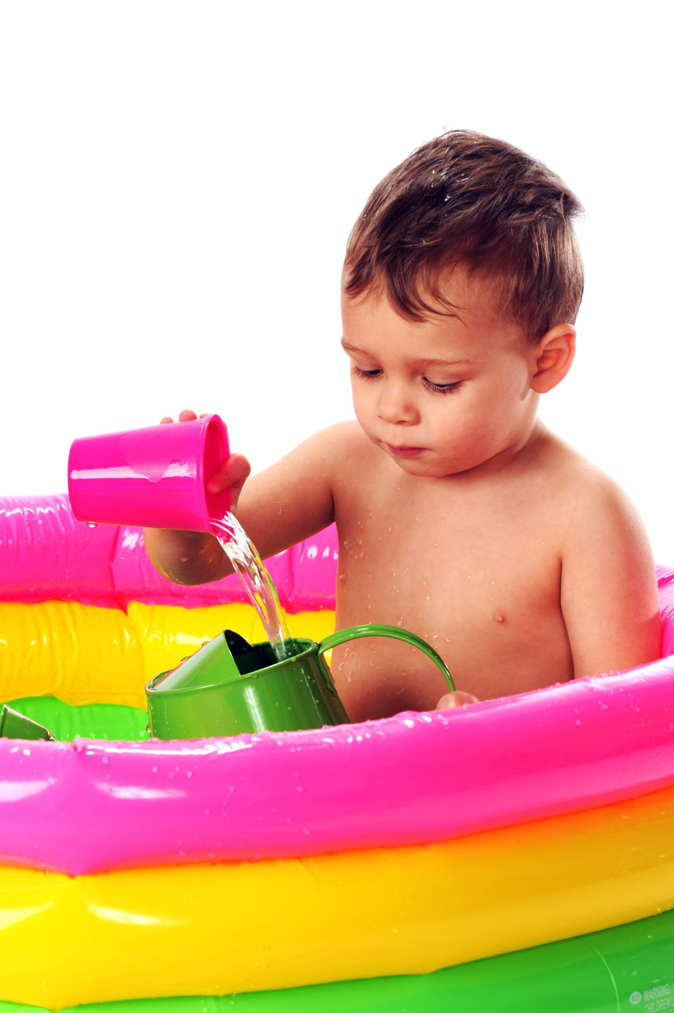 Child pouring water at a water table.
