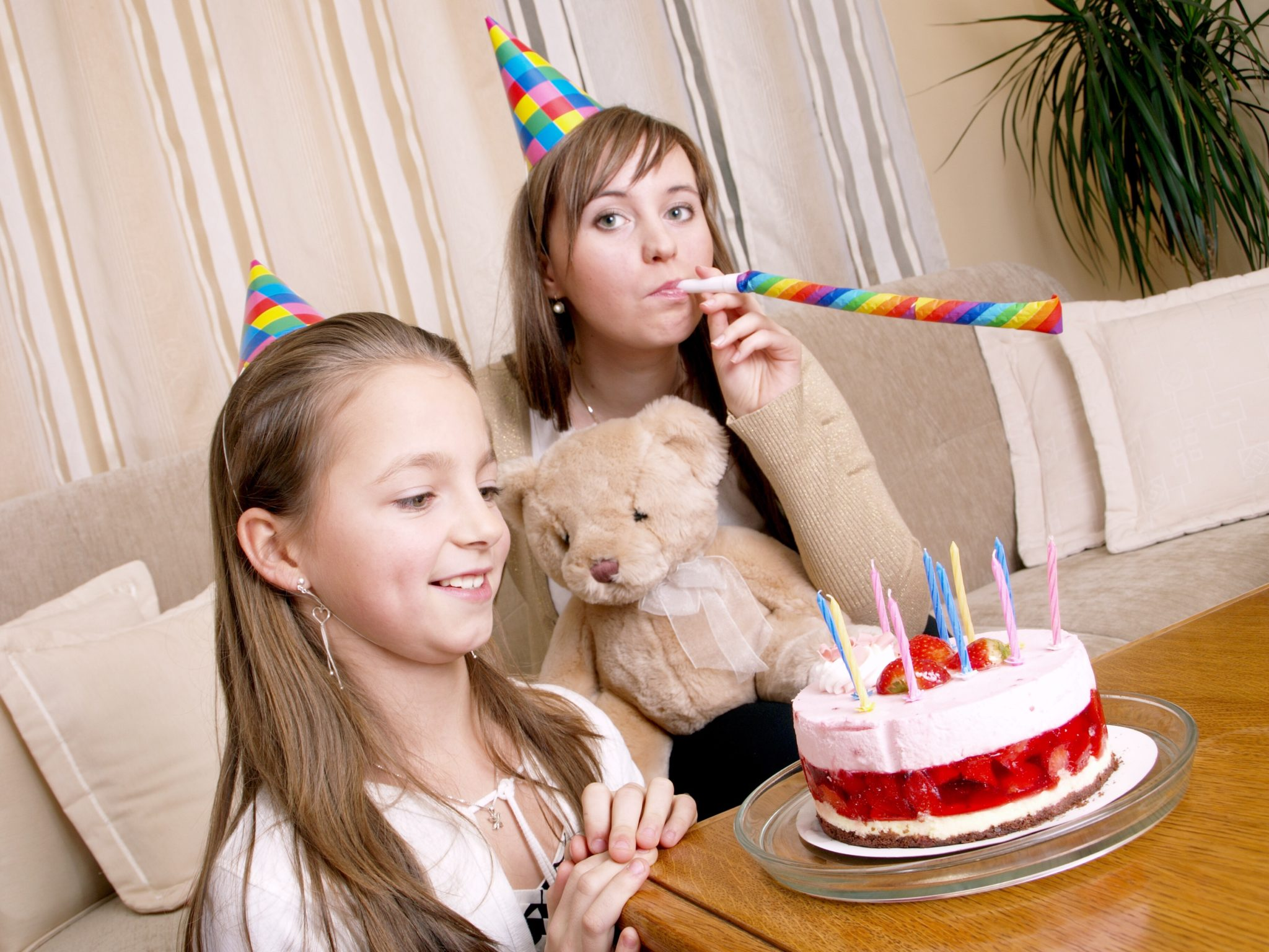 Mother and daughter with birthday cake.