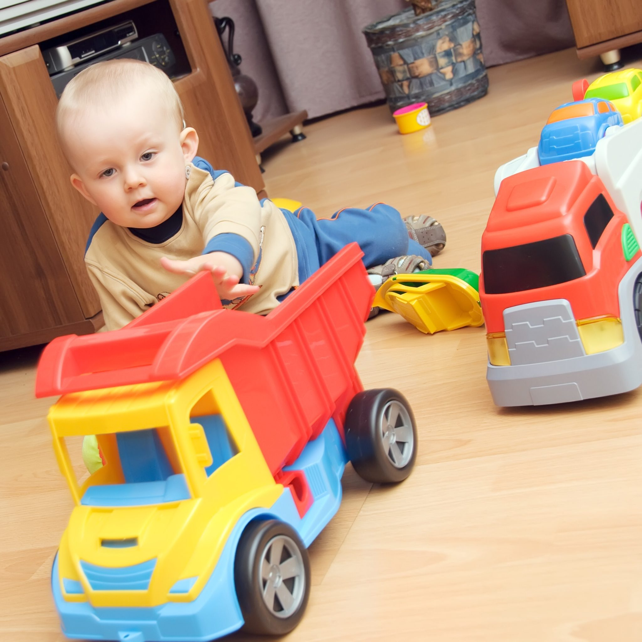 Boy playing with trucks.