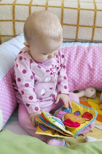 Baby reading book.