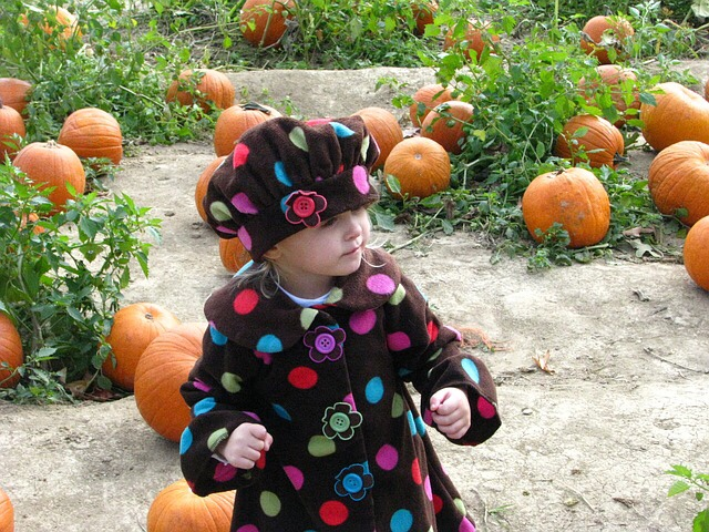 Girl in pumpkin patch.
