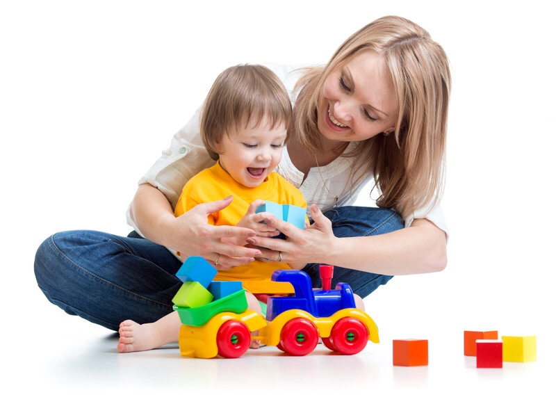 Mother and son playing with blocks