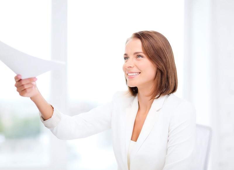 Business woman giving papers