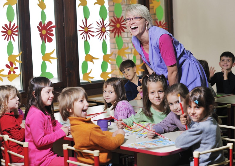 Children and teacher in preschool classroom