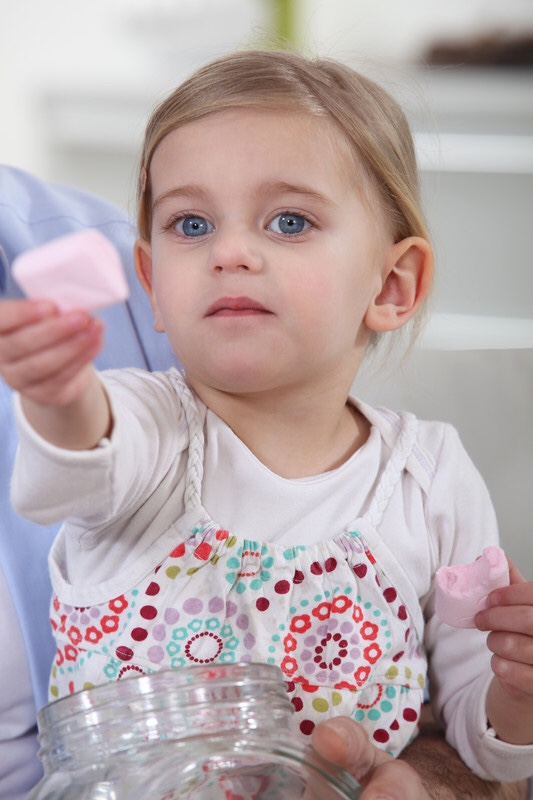 Girl offering marshmallows