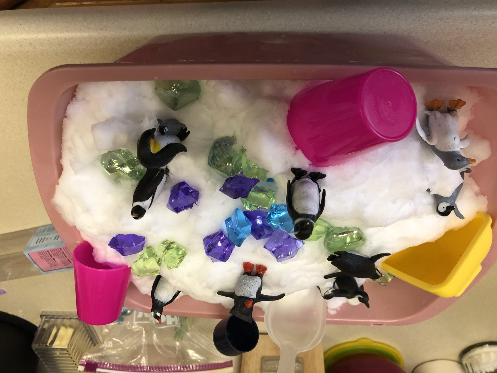 Snow sensory tub with shovels and cups