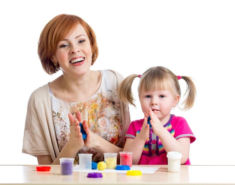 Mother and daughter enjoying play-dough