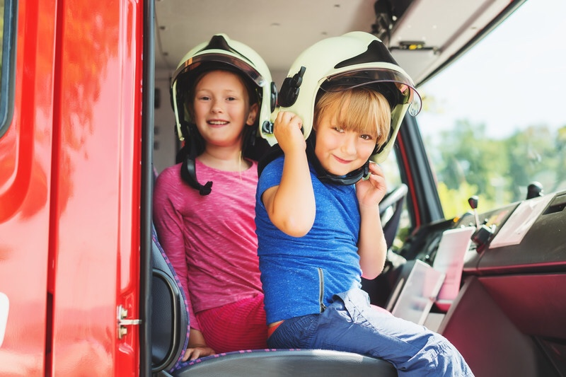 Children playing in fire truck learning about fire safety