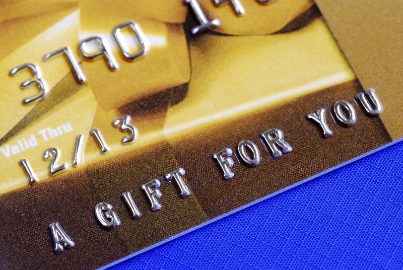 "Gold gift card that reads, ""A gift for you."""
