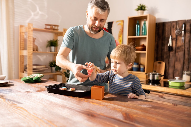 Father and son making Valentines gift for mom