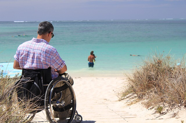 Person in a wheelchair on the beach