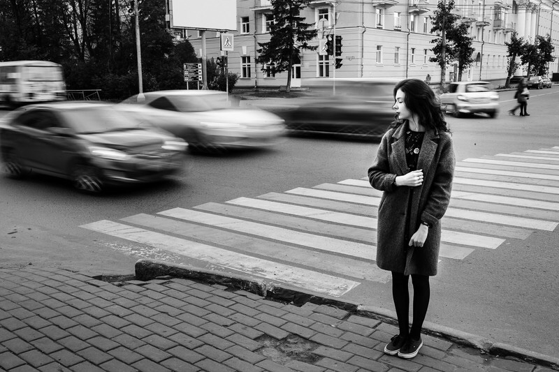 Girl waiting to cross the street