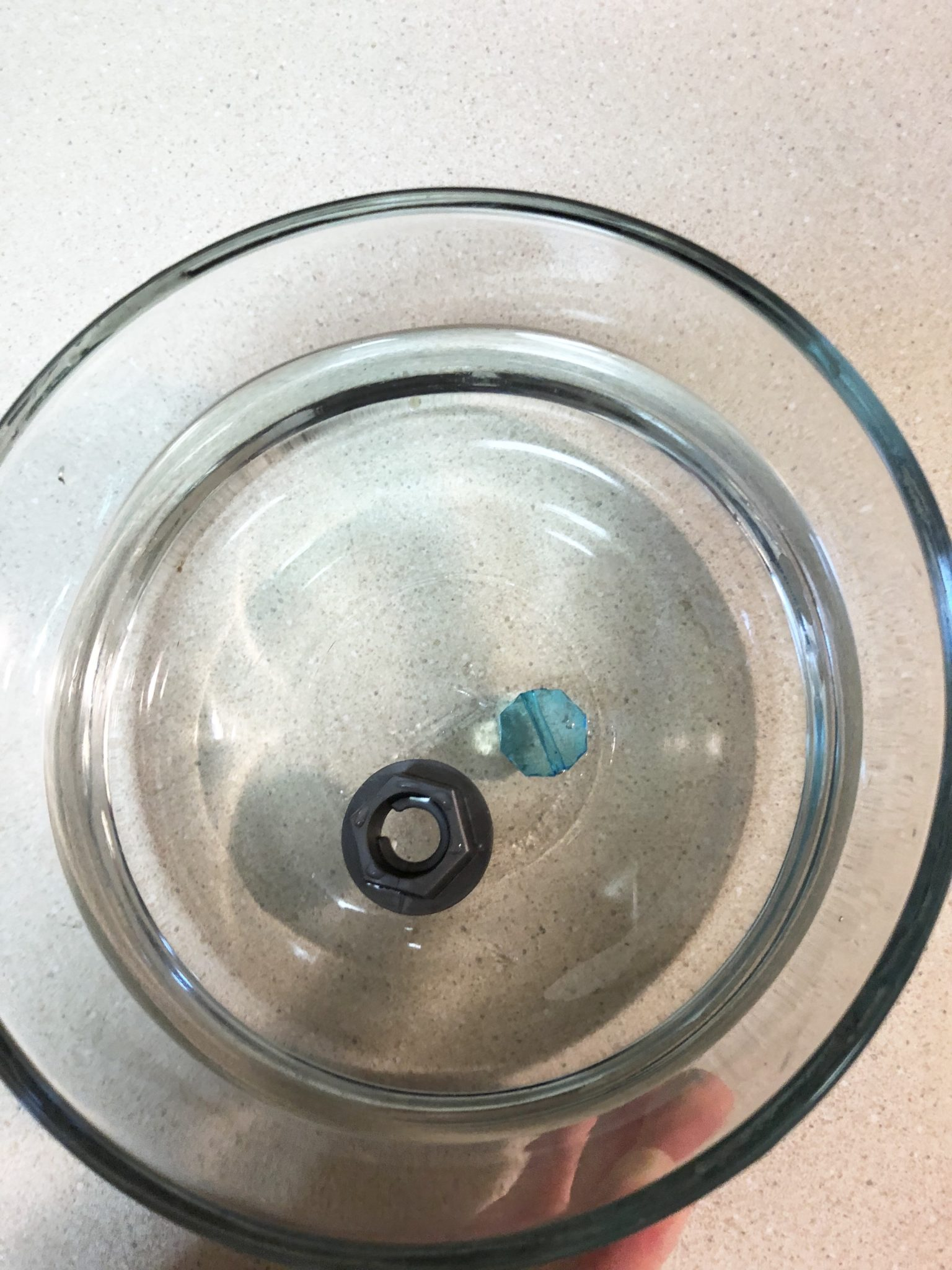 Plastic nut floating in water.