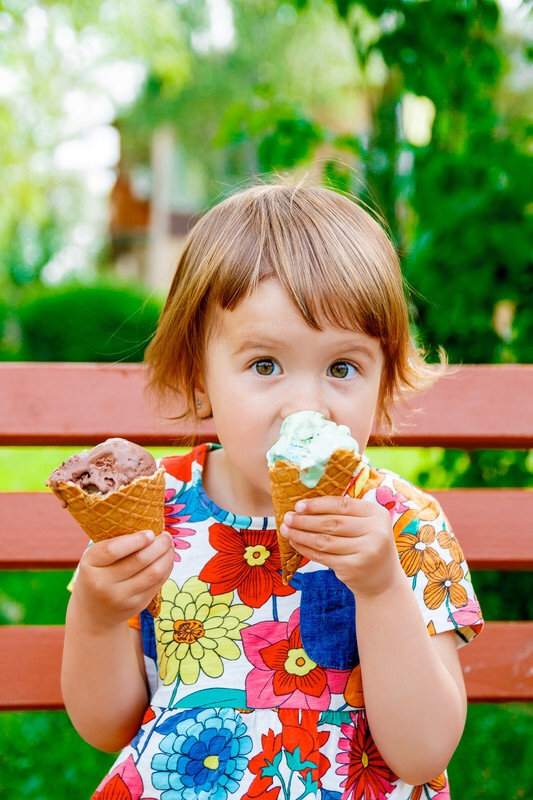 Little girl eating ice cream.