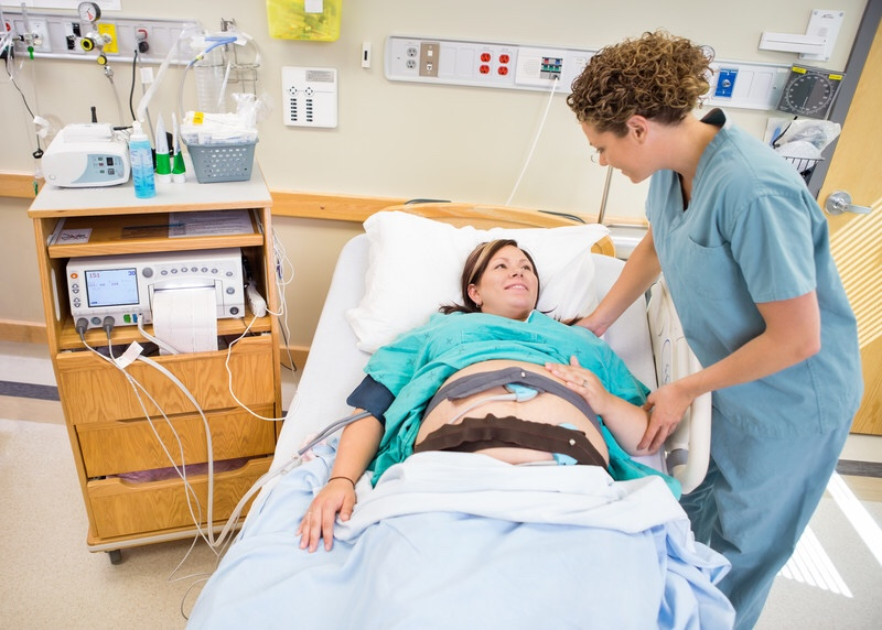 Pregnant woman with nurse in the hospital