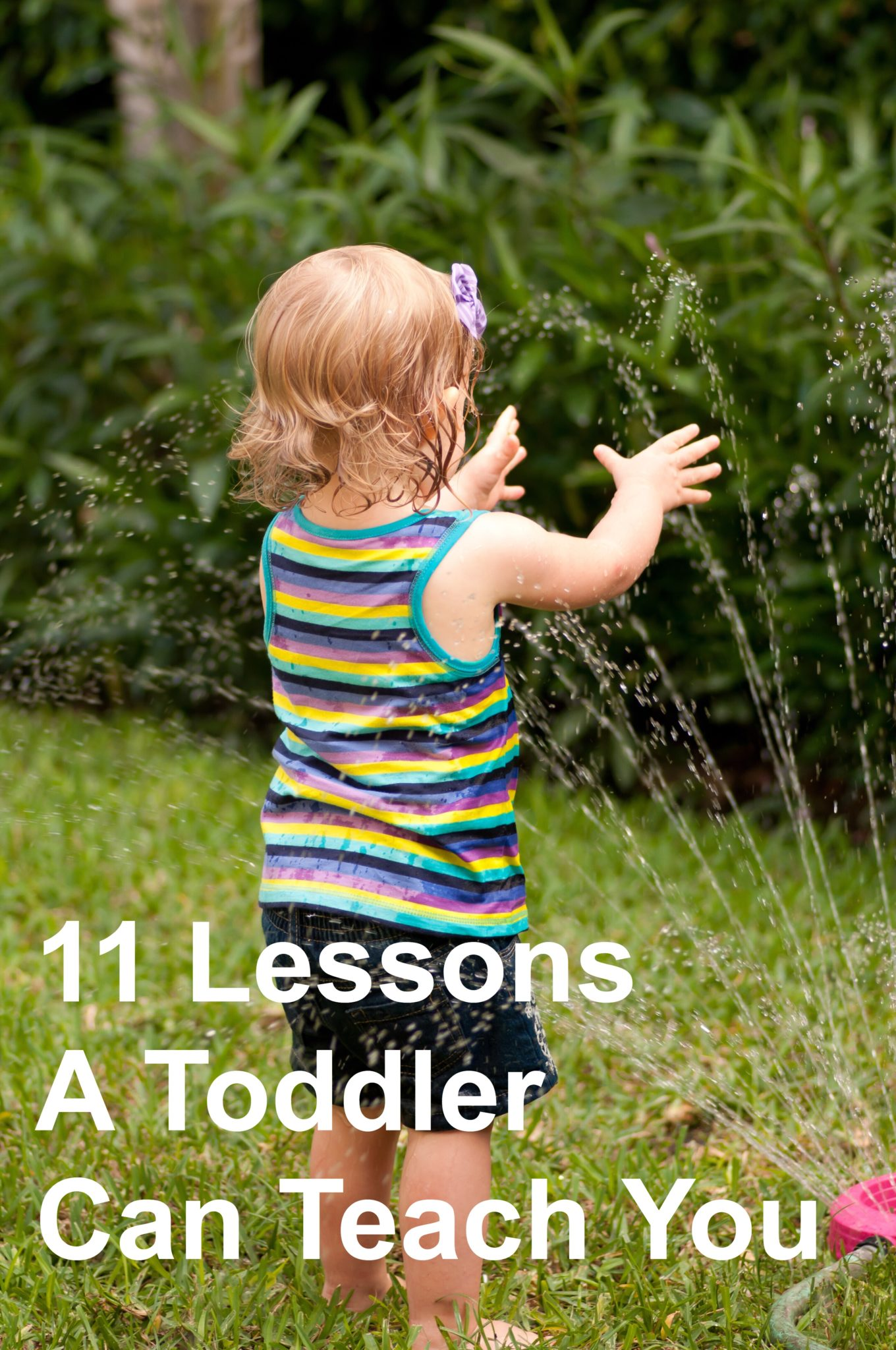 11 Lessons A Toddler Can Teach You. Toddler girl playing with hose, pin.