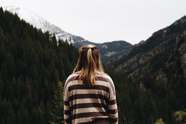 A thoughtful woman looking towards a mountain