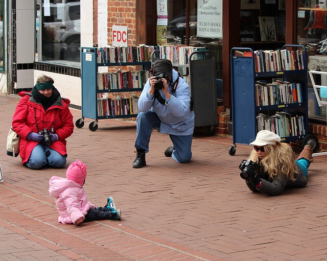 Photographer taking photos of a baby