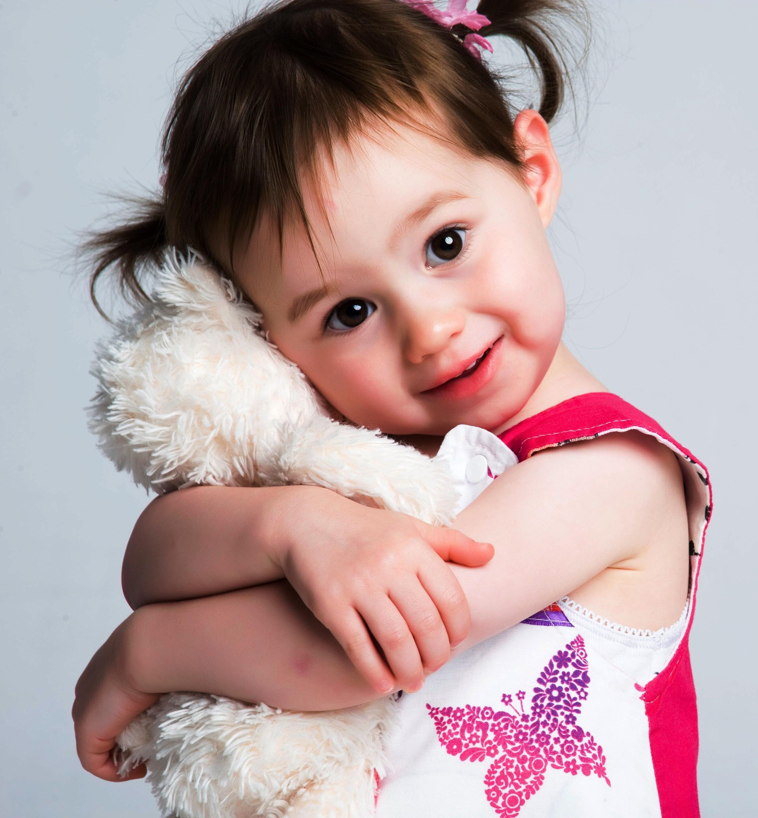 Little girl hugging stuffed animal