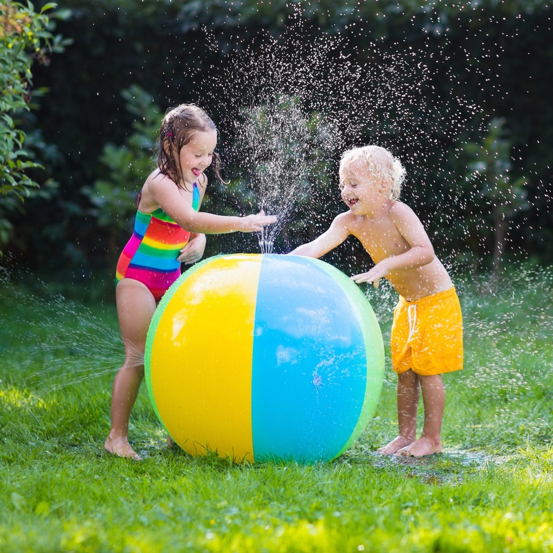 Two children playing with water ball