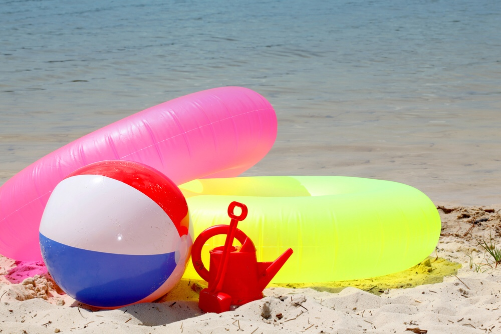 Water toys on a beach