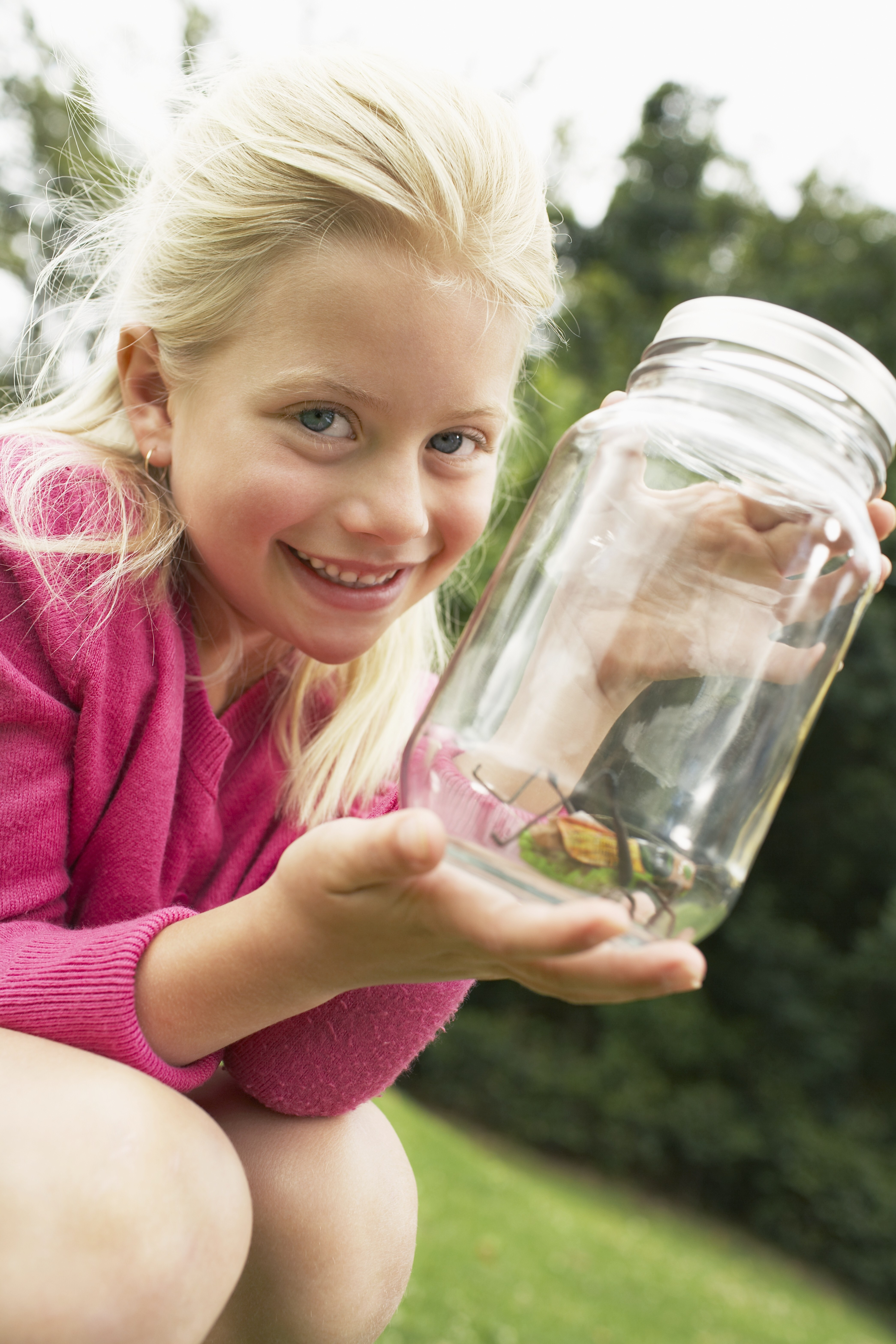 Child with a bug in a jar