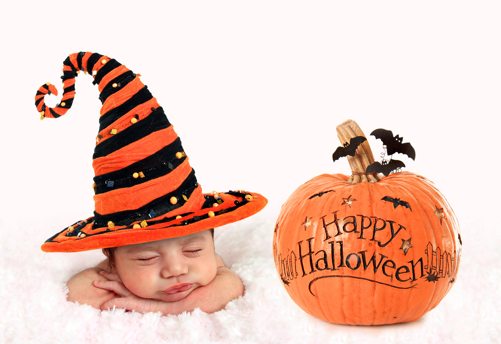 Halloween baby with pumpkin