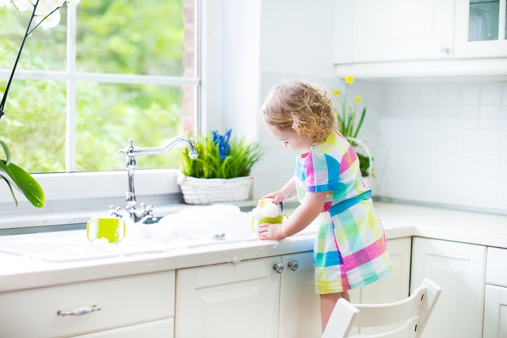 Toddler playing in sink