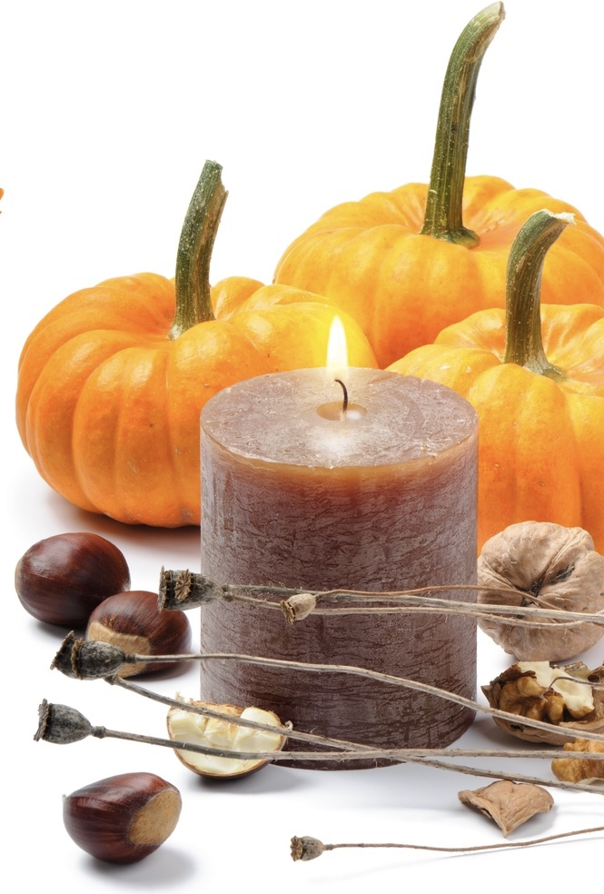 Autumn candle with pumpkins