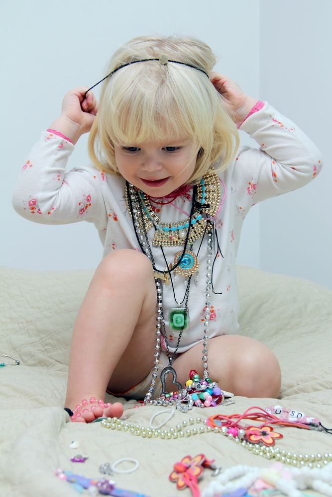 Little girl playing with jewelry