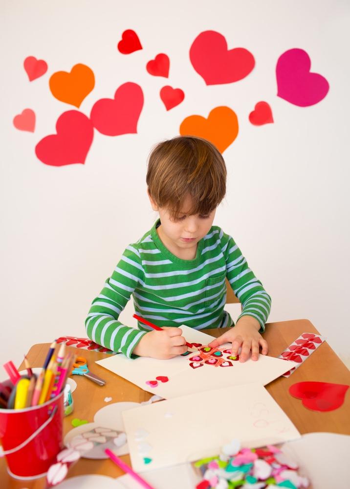 Kid making Valentine's cards